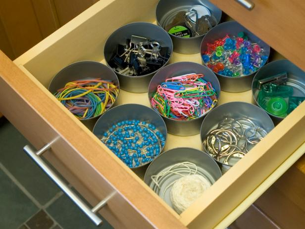 15 ways to organize with tin cans - desk drawer with tuna cans for office supplies
