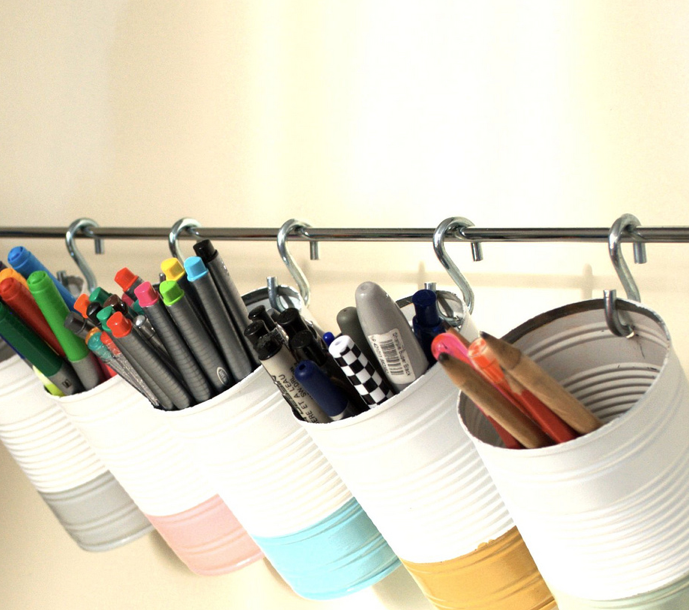 15 ways to organize with tin cans - hang supplies with Ikea bar and hooks